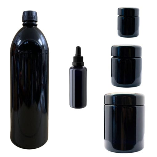 Picture of three Miron Violet Glass jars, a tincture bottle and a water bottle.